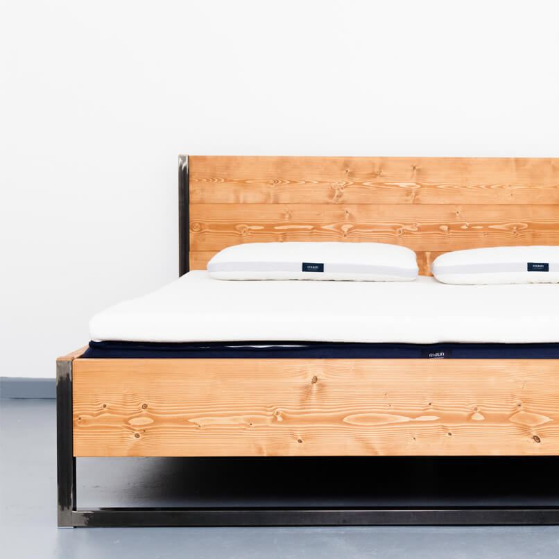 A bed made from recycled timber and steel