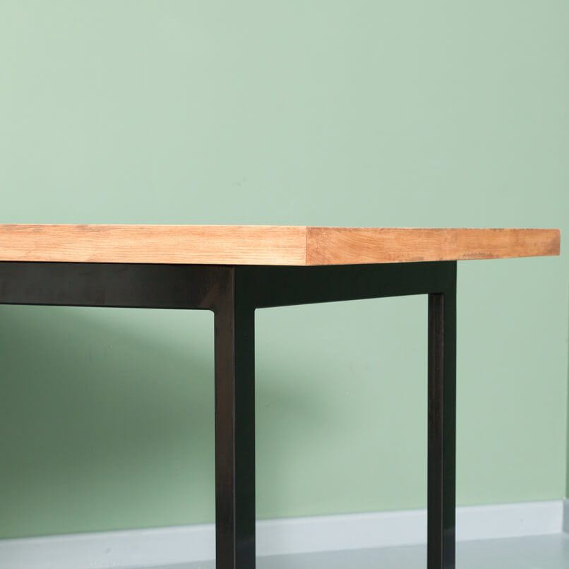 A dining table made from recycled timber and steel