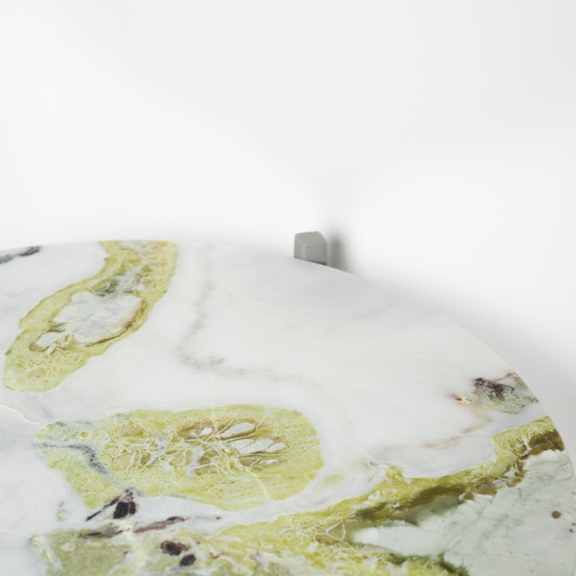 JOHANENLIES | A side table of lotus green marble and powder-coated steel.
